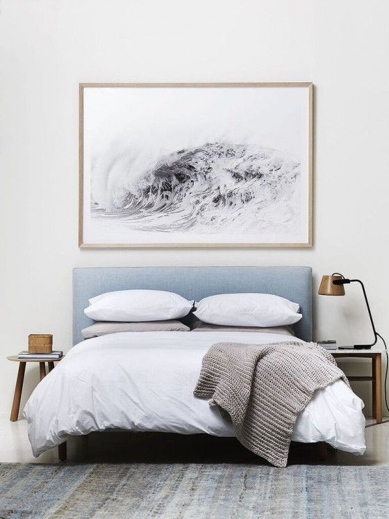 bedroom styling // gorgeous powder blue upholstered bed, white bedding, oversized art above bed, mismatched side tables