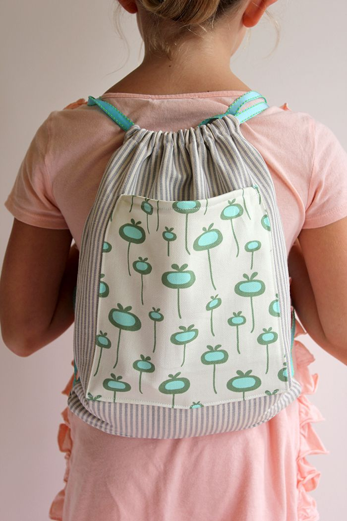 homemade drawstring backpack in stripe with floral pocket on front