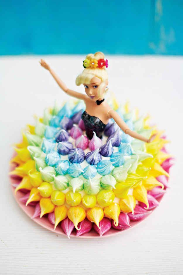 This is a Barbie doll wearing a skirt made of cake, covered in frosting, and decorated with meringue kisses. | These Meringue Kisses Want To Be The New Cupcake