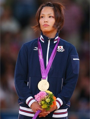 Matsumoto Kaori of Japan poses on the podium after winning goldinthe women's -57 kg Judo on Day 3 of the London 2012 Olympic Games at ExCeL.