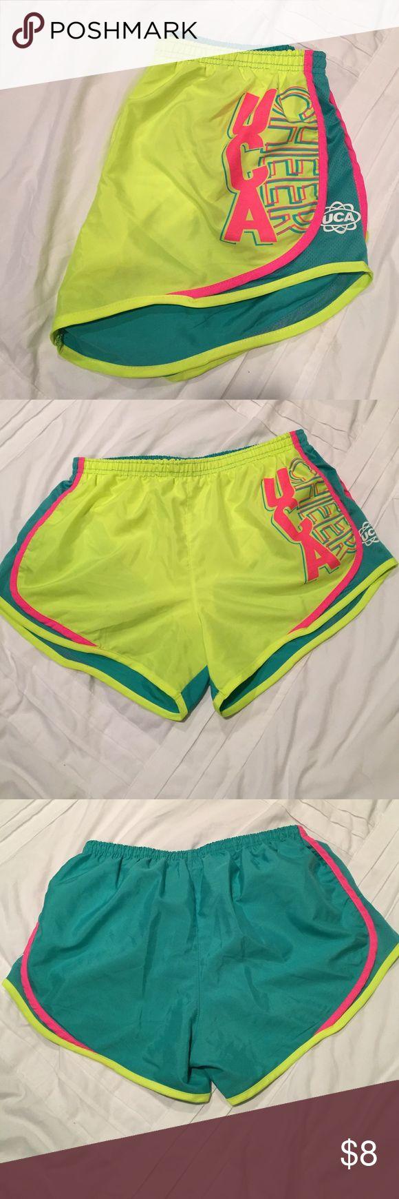 Varsity UCA Cheer Active Shorts NEW, UCA Cheer shorts, bright neon color, runs small (says large but probably more of a medium), inside liner, drawstring to tighten Varsity Shorts
