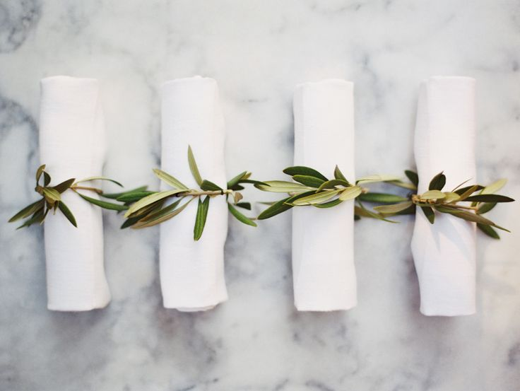 Olive branch napkin holders: http://www.stylemepretty.com/2015/07/29/30-details-for-an-organic-naturally-elegant-wedding/