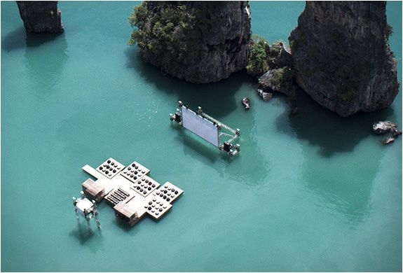 This amazing scenery is in the rocky shoreline of Yao Noi, Thailand. TheArchipelago Cinemais part of the event organized byFilm on the Rocks Yao Noi, a new film festival curated by Apichatpong Weerasethakul and Tilda Swinton. The auditorium raft was designed by German-born and Beijing-based architect Ole Scheeren, it was built using recycled materials. The guests are taken to the awe-inspiring glowing raft by boat, in the middle of the quiet waters of Nai Pi Lae lagoon on Kudu IslandFilm Festivals, Filmfilmfilm, Movie Theater, Thailand, Film Film Film, Movie Night, Places, Floating Cinema, Favorite Recipe