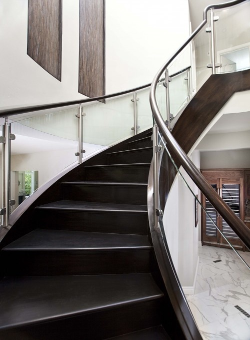 Love the glass railings for the stairs. Love the idea, would hate to clean, if I had kids. ha.
