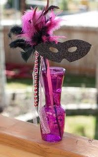 masquerade party centerpieces. Put a mask for each guest in them. It's okay to make them different but that might start a childish fight about who … | Party de…