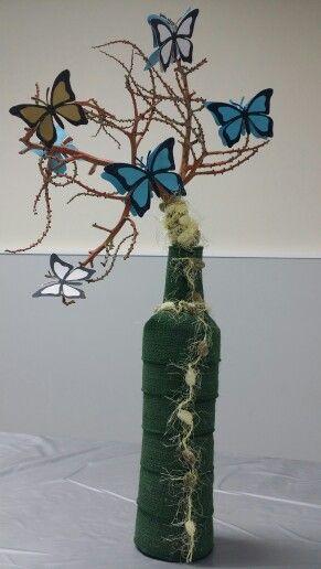 Botella adornada + mariposa de papel