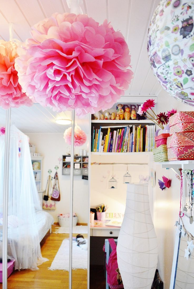 Kids room. Ideas for girls rooms. Pretty pink and DIY. Paper butterflies and silk paper pom poms. A hidden desk is a perfect way to save up on floor space.