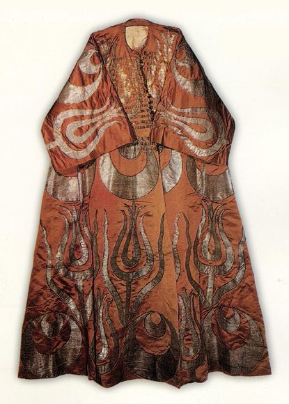 Short Sleeve Appliqued Kaftan of Murad III. (1574-1595), Identical in pattern to a 17th century Kaftan associated with Suleyman III except their lengths are different and this one had Banded closures and the later one just buttons. TPM 13/195