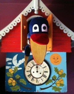 Mr Crow in his clock.