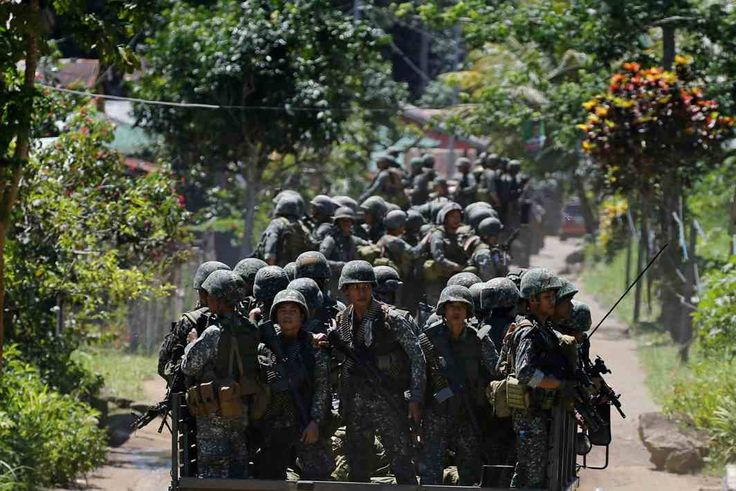 Philippines army soldiers ride in trucks into the fighting zone as government troops continue their assault against insurgents from the Maute group in Marawi City, Reuters/UNI