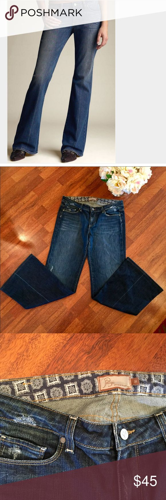 Paige Premium Denim 'Robertson' Paige Premium Denim 'Robertson' jeans. Distressed finish with flared legs.  98% cotton, 2% spandex. Approximate measurements: waist 34 inches, rise 9 inches, inseam 30.5 inches, cuff 22 inches. Paige Jeans Jeans Flare & Wide Leg