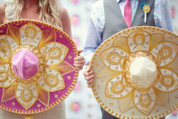 Get fun for your wedding with colorful bedazzled his and hers sombreros #spanish #wedding #brideandgroom