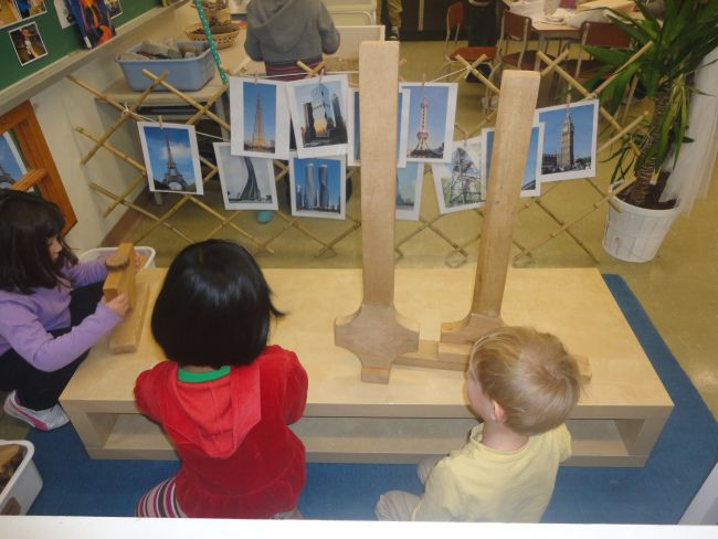 Tower inquiry at the small building centre. Photos of famous towers from around the world are clipped to the centre to inspire the students' designs.