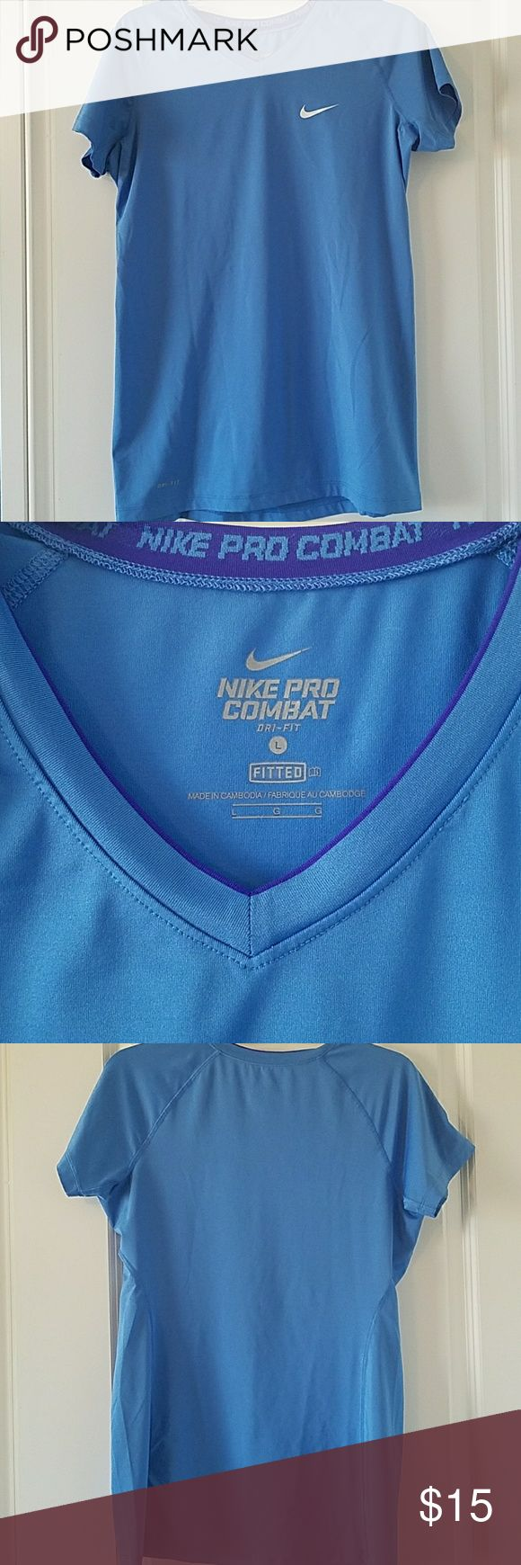 Nike Pro Combat Dri-Fit Short Sleeve Shirt Great light blue color.  Fitted.  EUC Nike Tops Tees - Short Sleeve
