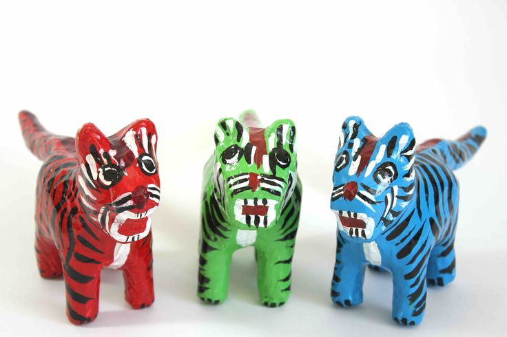 Papier-Mache Tiger: This handcrafted paper-mache tiger was made using recycled newspaper.  Each one is hand painted making them all unique and individual.  It is sure to add colour and happiness to the room.