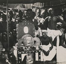 The Golden Stool (Ashanti-Twi: Sika 'dwa) is the royal and divine throne of the Ashanti people. According to legend, Okomfo Anokye, High Priest and one of the two chief founders of the Asante Confederacy, caused the stool to descend from the sky and land on the lap of the first Asante king, Osei Tutu. Such seats were traditionally symbolic of a chieftain's leadership, but the Golden Stool is believed to house the spirit of the Asante nation—living, dead and yet to be born.