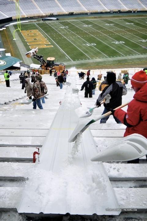 Fans remove snow from Lambeau Field