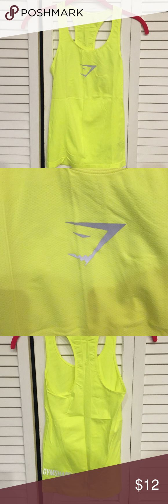 Gymshark Neon Yellow Tank Gymshark Neon Yellow Tank. Size S. Never Worn. Smoke free home. Gymshark Tops Tank Tops