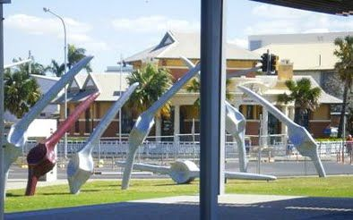 'Fishbones' red fishbone - glass mosaic by Emma Boys for Urban Art Projects Bluewater Trail, Mackay.  Designed by Fiona Foley.