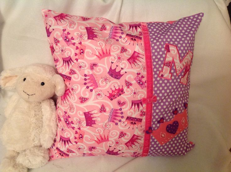 Handmade cushion with appliqué initial and hand drawn, cut and stitched crown