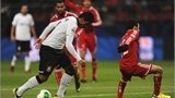 TOYOTA, JAPAN - DECEMBER 12: Paulinho of Corinthians tries to shoot while Ahmed Kenawi of Al-Ahly turns during the FIFA Club World Cup Semi Final match between Al-Ahly SC and Corinthians at Toyota Stadium on December 12, 2012 in Toyota, Japan. (Photo by Kaz Photography/Getty Images)