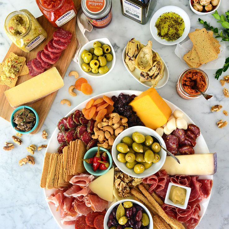 Italian Feast Collection   Everything you love about entertaining with tasty Italian antipasti in one larger-than-life gift collection. This awe-inspiring masterpiece stars a vast variety of our best-loved antipasti along with an extraordinary lineup of hand-selected specialty cheeses, cured meats, crispy crostini toasts, dried fruits, nuts and signature DeLallo goodies like Italian Extra Virgin Olive Oil and our exclusive Dipping Spice Collection.