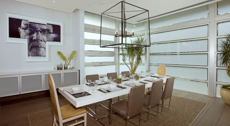 The casual dining room seats eight with slatted windows that open onto the outside.  (McClean Design)