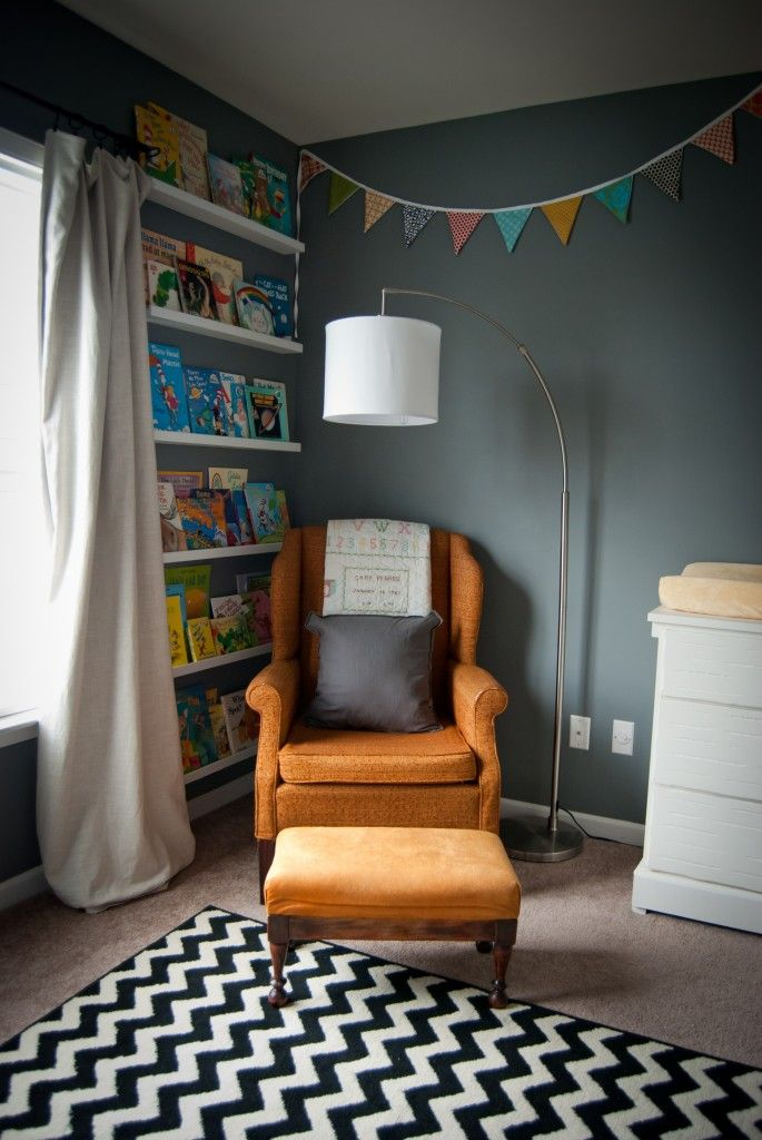 Nursing/Reading Corner in the Nursery - love this colorful, eclectic nursery!Nurseries Inspiration, Bookshelves, Baby Reading Corner, Reading Corners, Bookshelf Wall, Embrace Spaces, Grey Wall, Nursing Reading Corner, Girls Nurseries