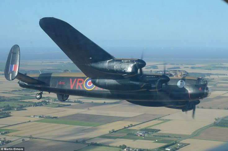 Flight of a lifetime: The Canadian Lancaster bomber flies above the UK as MailOnline films footage from a light aircraft soaring just feet away