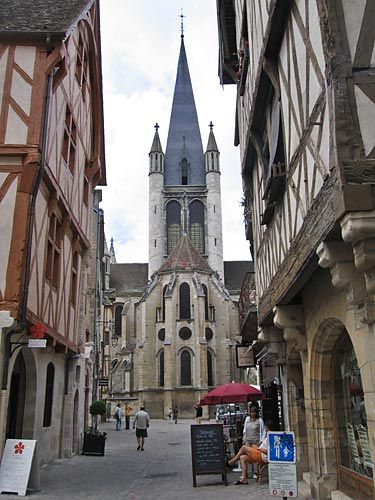 Dijon, France...I love the combination of architectural styles in Dijon...the half-timbered buildings beside the gothic and romanesque churches.