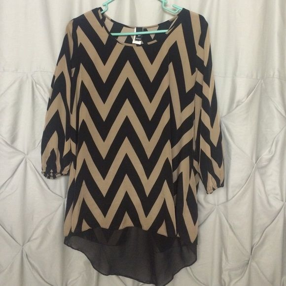 Black and tank chevron blouse Size: Medium 100% polyester  this shirt fits flowy. short in the front and long in the back. Perfect for leggings cause it covers your butt! WINDSOR Tops Blouses