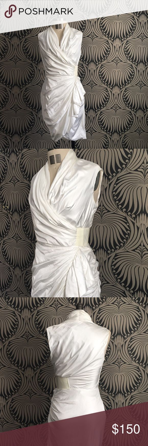 Allsaints White Wrap Draped Dress Silky white fabric drapes beautifully around the body in this sexy wrap dress by Allsaints. US size 6. Dress is new with tags attached, never worn and in near perfect condition- There is one tiny mark on the upper back (not very noticeable) and transfer from the ink on the tag on the inside lining. This is not at all visible when you are wearing the dress. Please see photos. Gorgeous dress! All Saints Dresses Asymmetrical