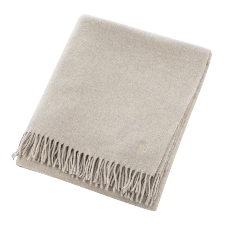 Keep a layer of warmth to hand with this Must Have blanket from Zoeppritz. Luxuriously soft to the touch, the blanket features a tasselled edge finish and a discreet logo. Made from 100% virgin wool,