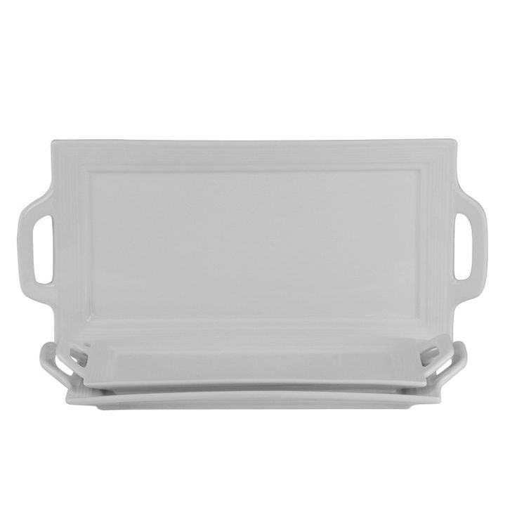 Contemporary Rectangular Serving Platters. Use for family dinners, formal dining and more! The contemporary and elegant white porcelain design blends well with most dinnerware pieces. Each is rectangular in shape with slightly raised edges and has built in handles.   eBay!