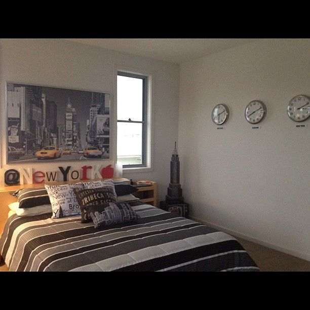 another photo of the new york loft style bedroom complete with world time zone clocks gold
