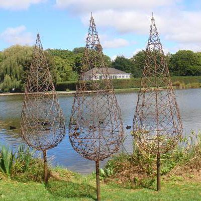 Use chicken wire and plant morning glories or clematis to climb...  barb wire trees from Wire Art NZ
