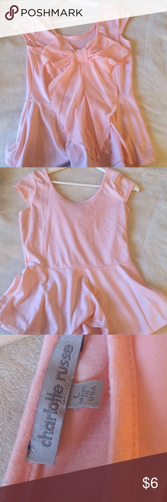 Peplum top Light pink peplum top! With a bow in the back! Charlotte Russe Tops Camisoles