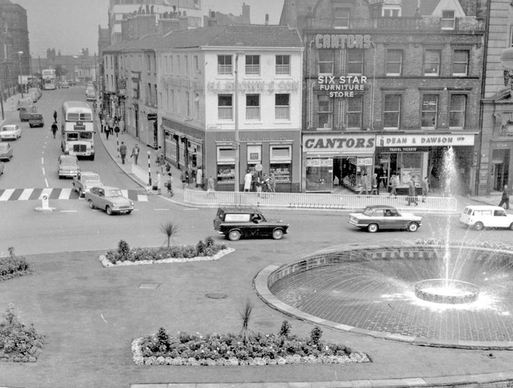Town Hall Square looking towards Fargate and Leopold Street, Goodwin Fountain, foreground, No 70, H.L. Brown and Son Ltd., Jewellers, No 68, Cantors Ltd., House Furnishers, No 66, Dean and Dawson Ltd., Travel Agents, Exchange Gateway #socialsheffield