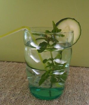 Cucumber water infused with mint leaves.