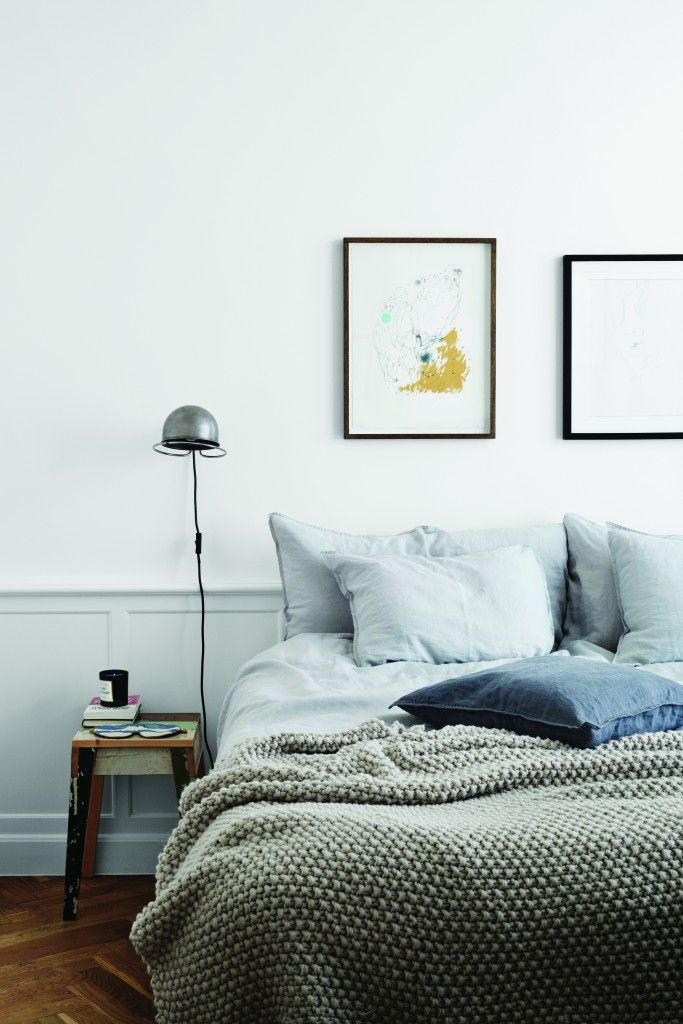 cool master bedroom // light greens and blues // wainscoting // textured bedding