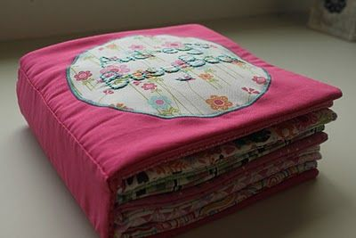 DARLING Busy Book. I like how the book sits so 'square'. Good way to sew pages to cover.