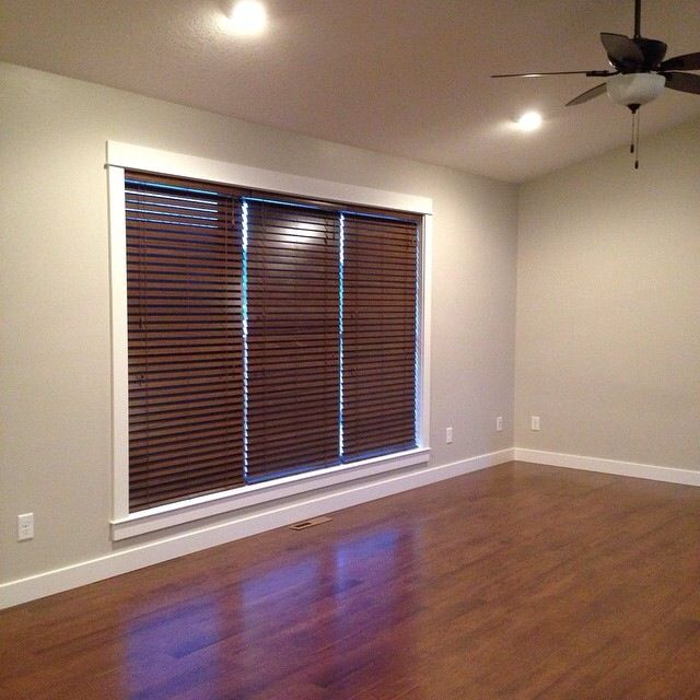 Living room with sherwin williams agreeable gray walls, and solid wood blinds
