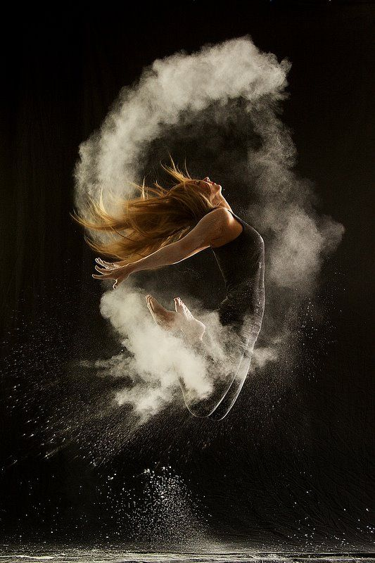 "Dancers leap and pose amidst explosions of powder in the photo series ""Powder Dance,"" by German photographer Geraldine Lamanna."