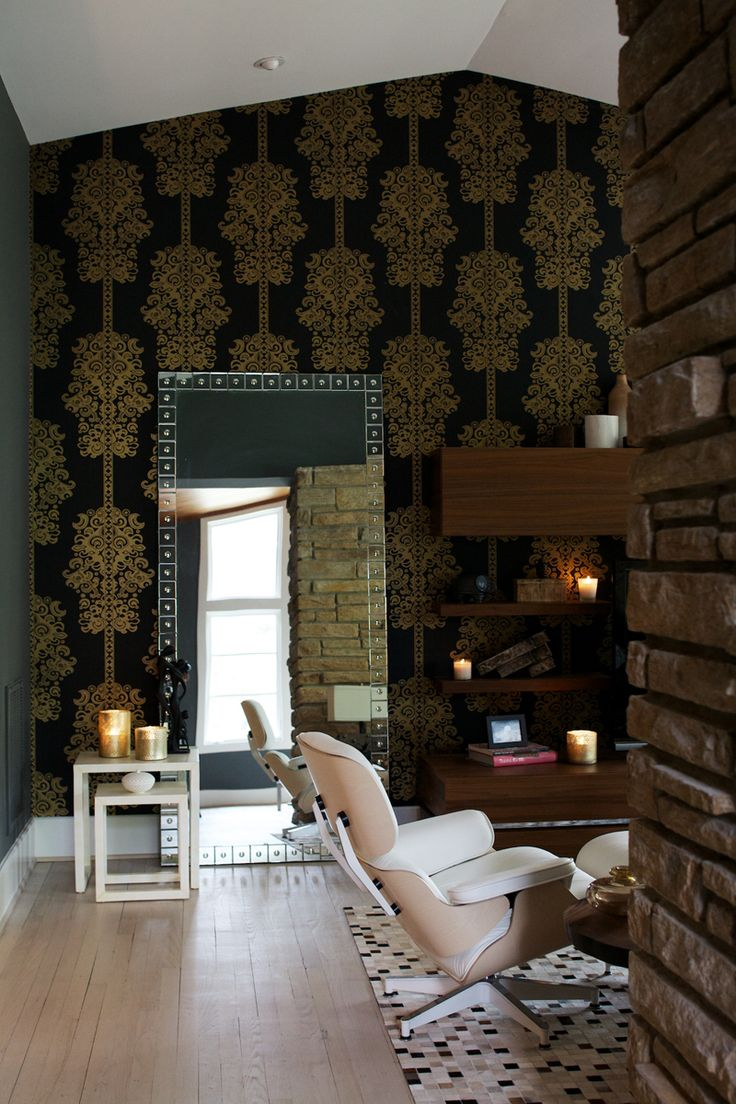 wallpapered office home design. floortoceiling black and gold wallpaper ups the drama of wall behind media console a leaning mirror reflects light from nearby window wallpapered office home design