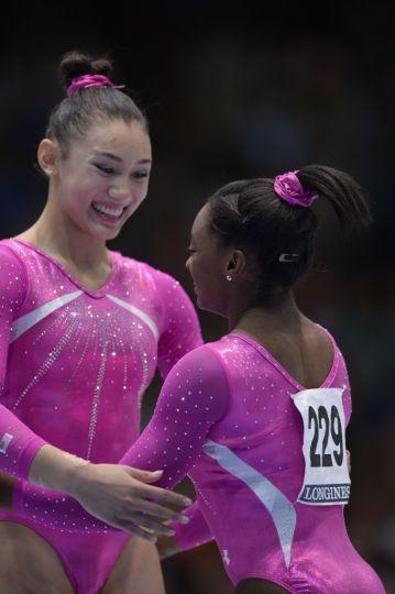 All-around gymnastics world champion Simone Biles and runner-up Kyla Ross celebrate.