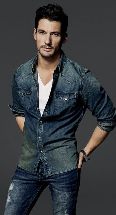 d2fb8b9872c57 David Gandy fall combo inspiration with a denim button up shirt with rolled  up sleeves white v-neck t-shirt silver banded watch distressed blue jeans  ...