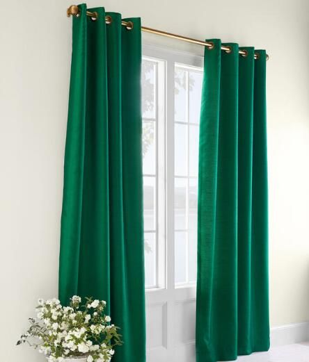 For the look of real silk without the expense, outfit your rooms in elegant style with our Faux Silk. (Country Curtains Premium Faux Silk Lined Grommet-Top Curtains. Available in Emerald Green and Burgundy.)