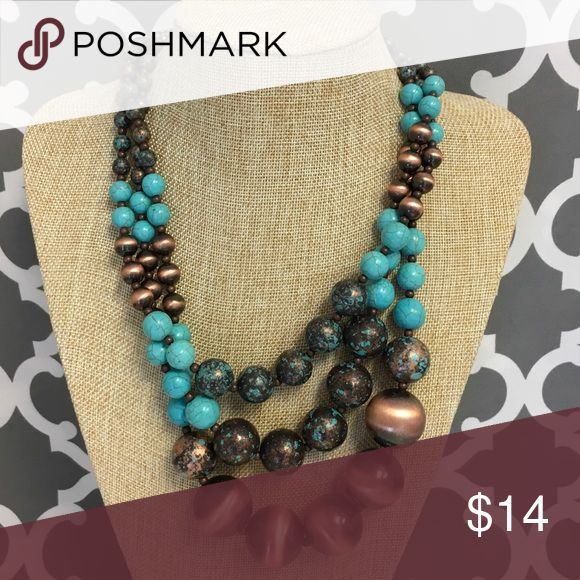 Bubble Bead Turquoise Copper Necklace Triple layer bubble bead necklace. Pretty combination of turquoise and copper bees. Lobster clasp adjustable and back. Matching earrings included. New with tags. Jewelry Necklaces