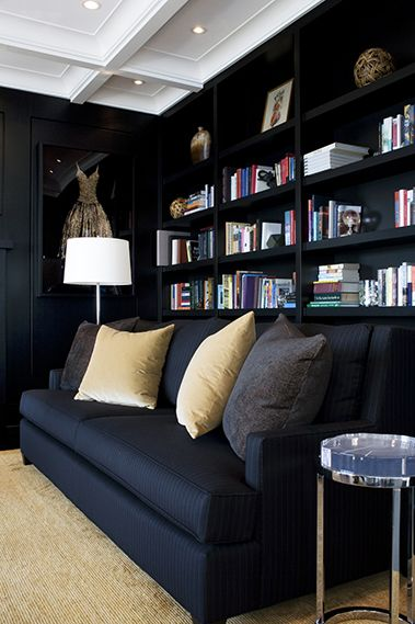 A library with black walls...Hmm