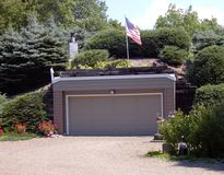 An earth-sheltered garage with unseen adjacent underground home